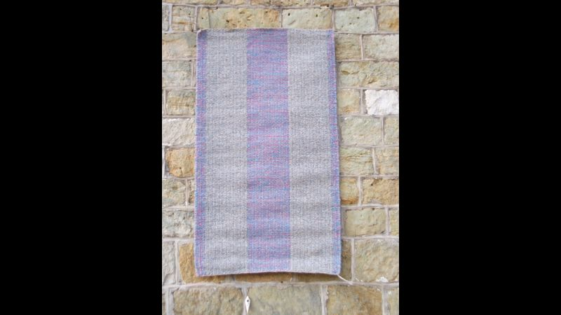Block weave rug in blues and pinks.