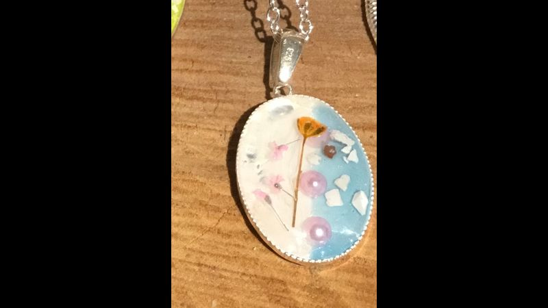 Real pressed flowers and silver necklace