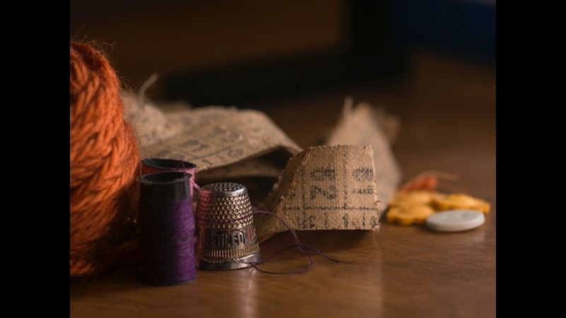 thimble and tape measure