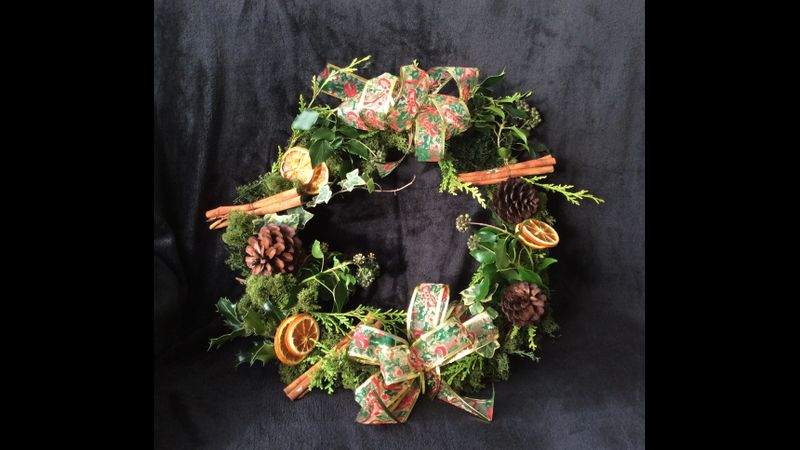 Fresh Christmas Wreath with lots of decorations