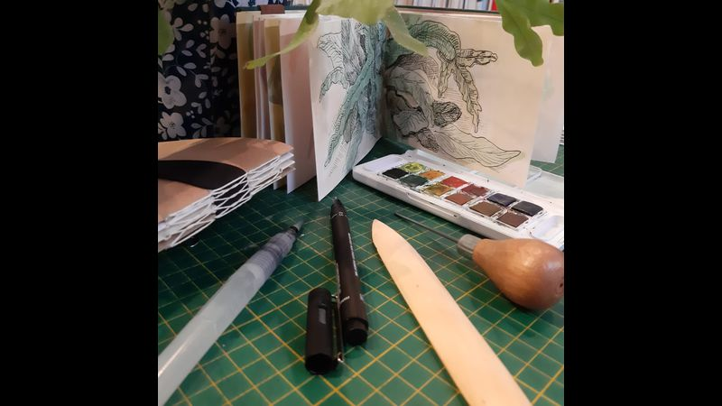Sketchbook and sketching and bookbinding tools