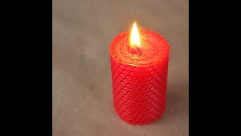 Red rolled candle