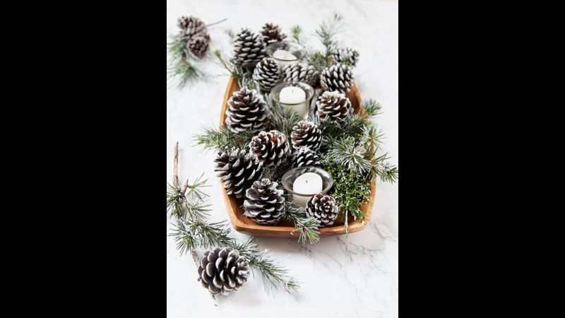 Painted pinecones festive table centrepiece