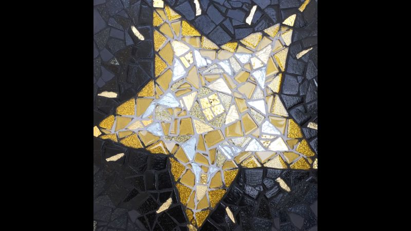 Christmas Star in several shades of  gold and silver glass
