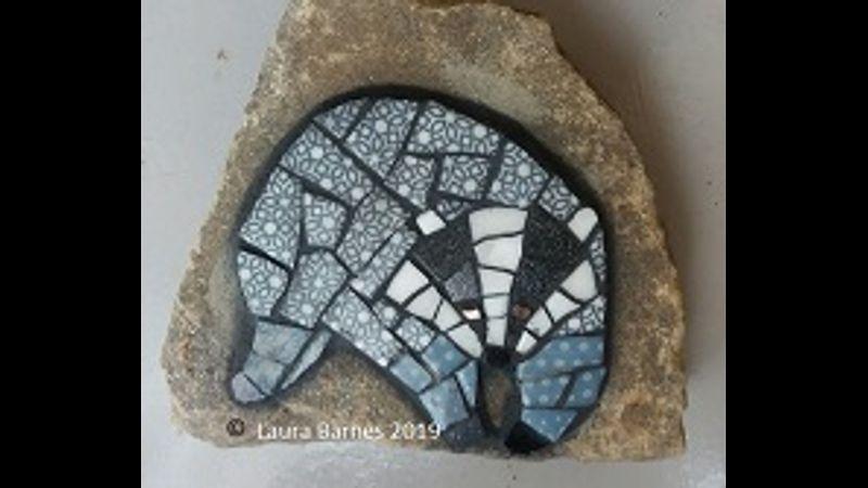 Badger mosaic on stone.