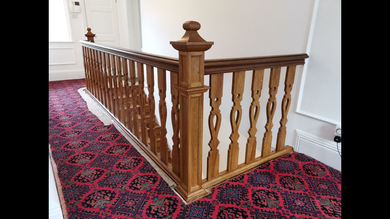 Painted balustrade given an aged oak woodgrain effect finish
