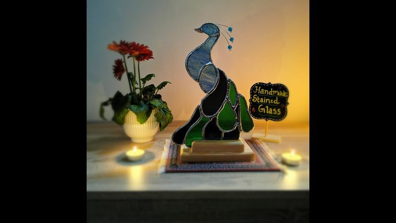 Majestic Stained Glass Peacock mounted on wooden stand with candle holder