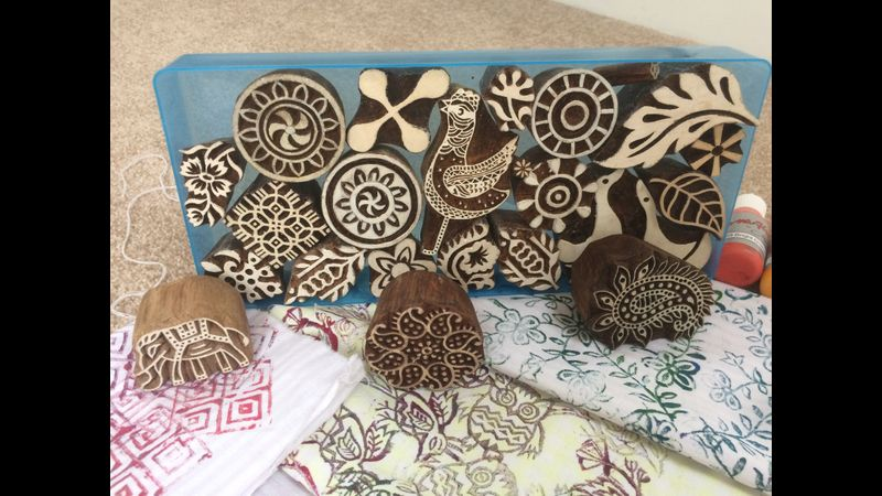 Hand carved wooden blocks are used with fabric paints