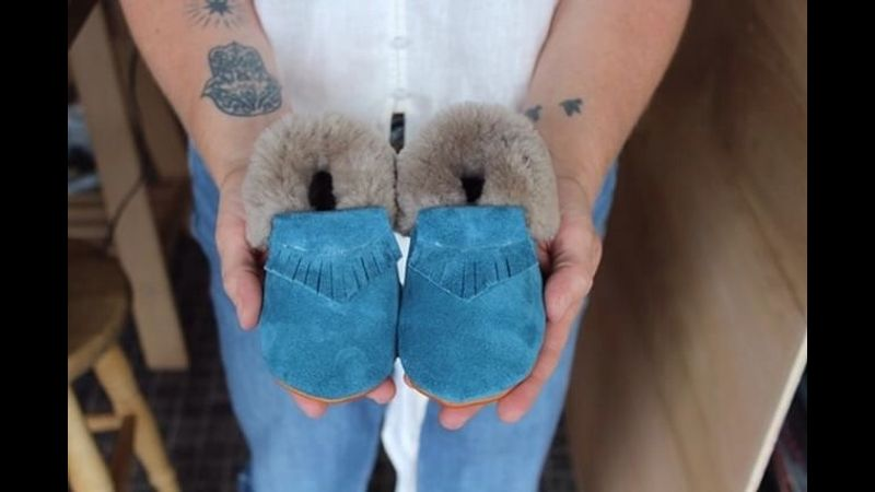 An adorable pair of baby moccasins to take home at the end of the day.