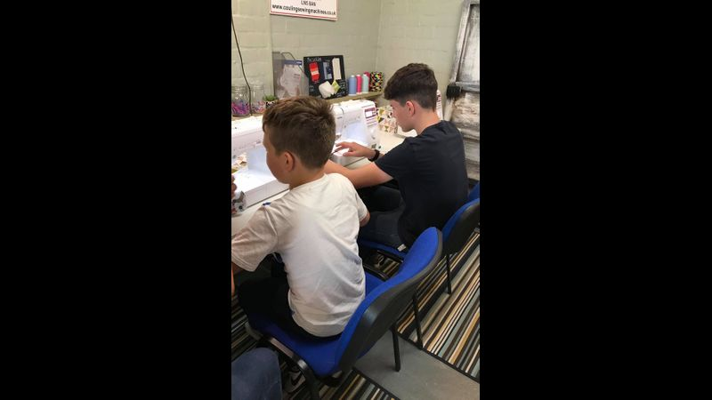 Children learn the basics of the sewing machine
