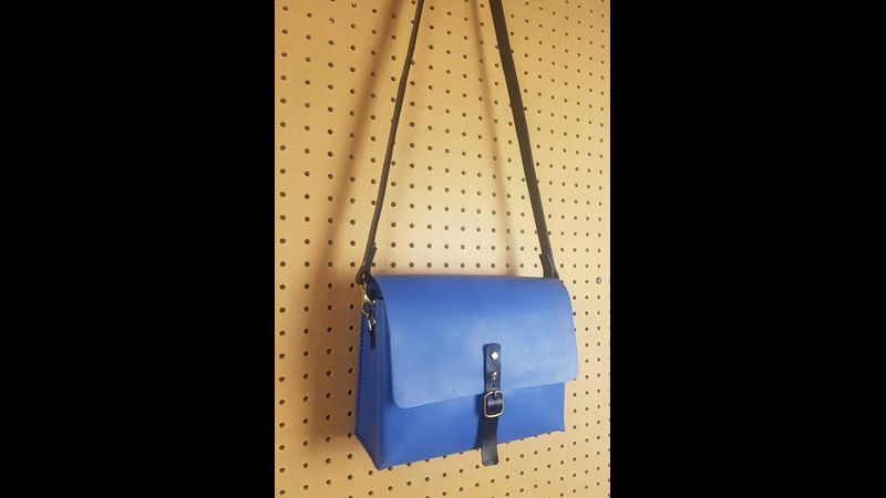 Blue cross body flap and buckle satchel