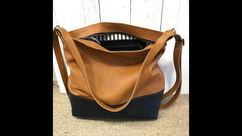 Helena's tan and navy leather tote/rucksack bag