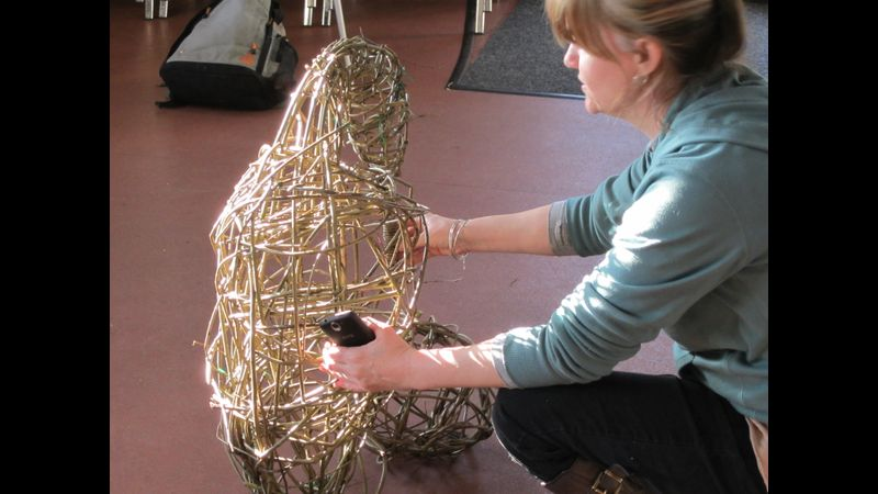 Student making willow penguin