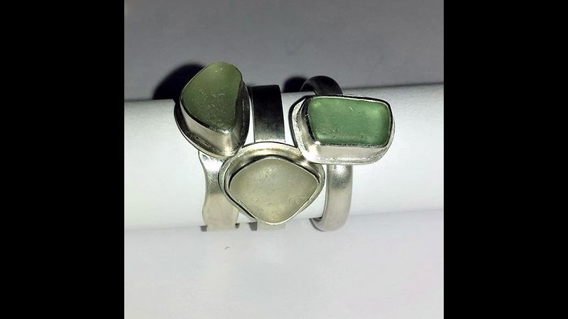 A collection of sea glass rings.
