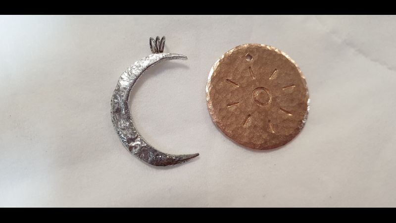 Reticulated silver moon and stamped  bronze, sun pendant, a lovely pair by a lovely couple!