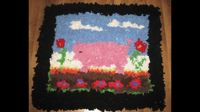 A pig in a field rag rug!