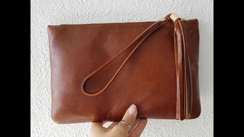 Finished leather clutch with handle