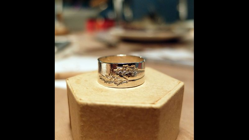 Wide silver ring with stamped heather pattern, made at the silver jewellery workshop in Wales