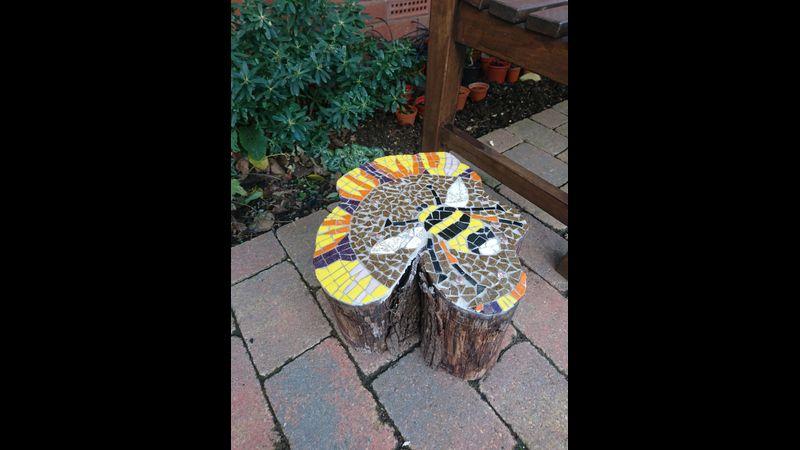 mosaic design on log