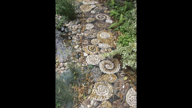 David James of Olicana Mosaics -shell pavement consisting of repeating forms around a pond.  Ilkley