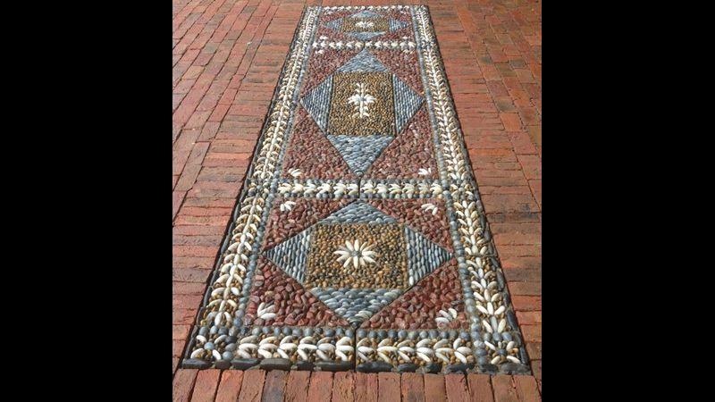 David James of Olicana Mosaics -Formal geometric pavement in a parterre garden.  Ilkley