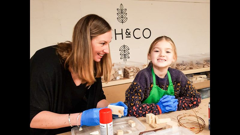 Mum and daughter enjoying quality time working together at an Ash & Co. Workshops Mini-Maker session