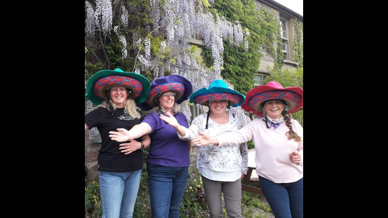 The Lovely Tory Dobbs and fellow Quadrillers in their Sombrarros fitting over their riding hats!