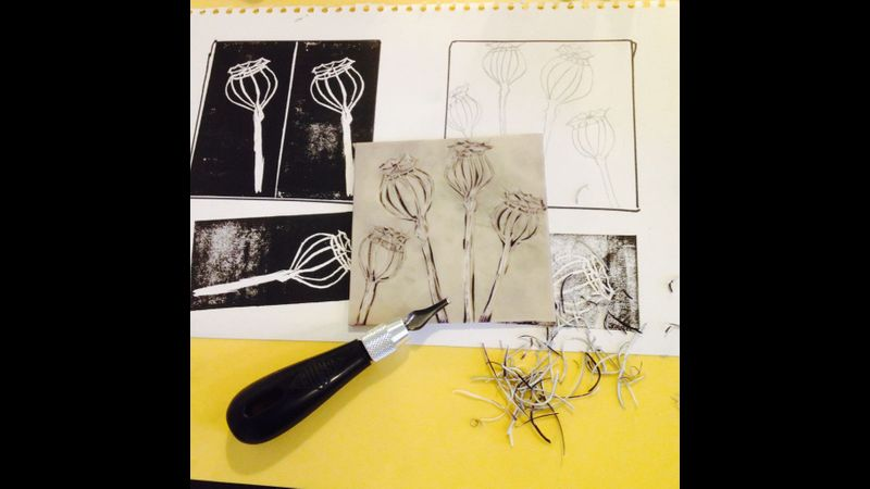 Learning how to create and cut a unique design on lino printing workshop in Edinburgh.
