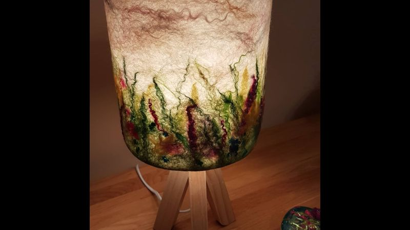 A felted lampshade with a grasslands theme-Claire Priestley.