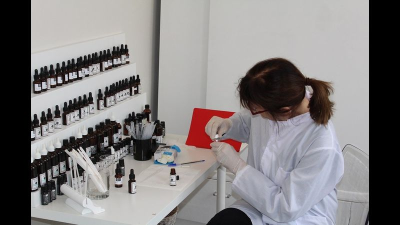 client in the lab creating perfume with me