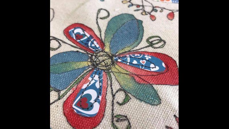 Free machine embroidered flower