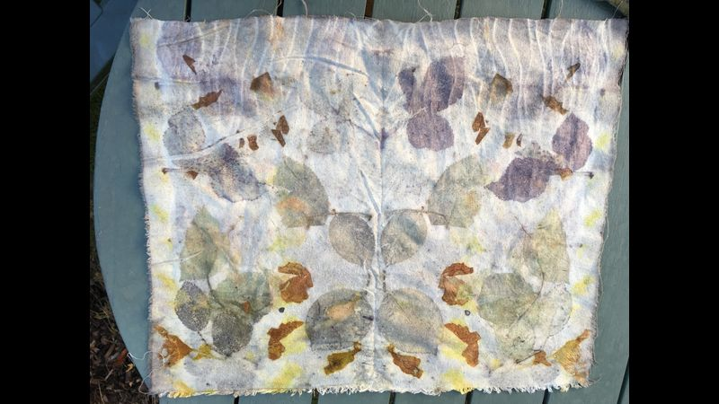 Symmetrical prints onto silk boil fabric. Upper edge of fabric is printed with geranium leaves.