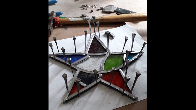 Stained glass star making in progress