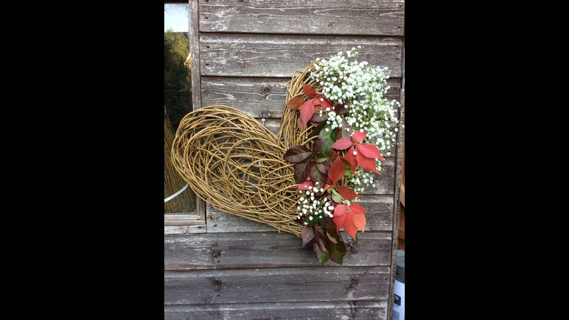 use your willow heart as a base for floral a arrangement