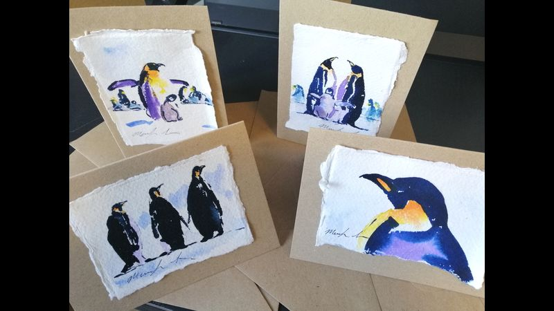 Four watercolour penguins on craft cards with envelopes