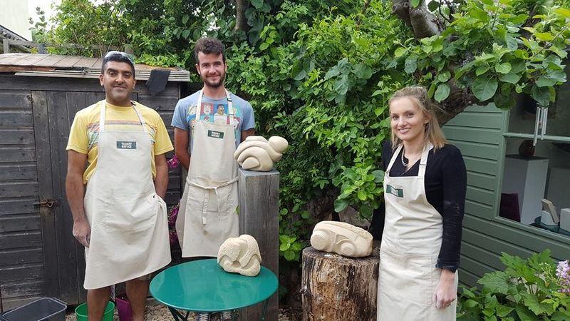 Proud first time carvers Kamran, Cameron and Katherine