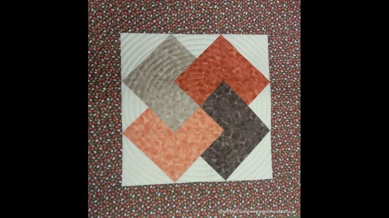 Spiral quilting on a 4 Card Trick patchwork block
