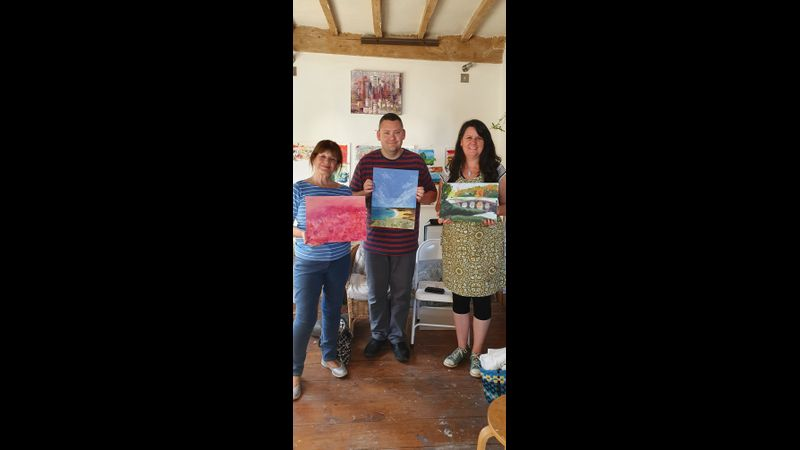 Mary, Trevor and Jeanette showing their finished paintings after just one day's tuition.