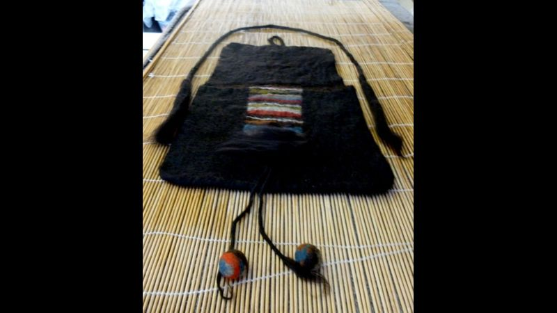Bag laid out for felting with handles and decoration.