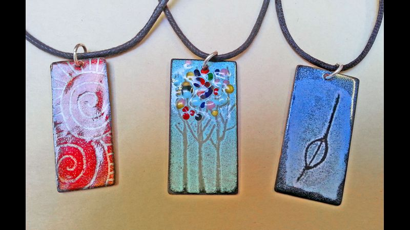 Three Pendants enamelled on copper by students