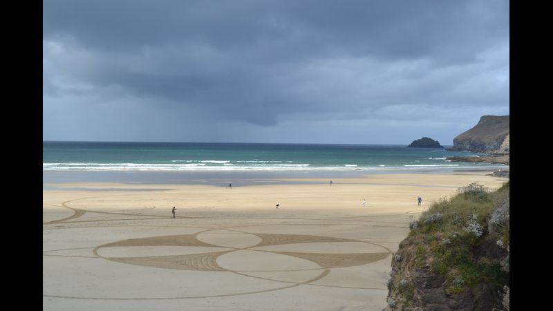 Big beach art on Polzeath Beach