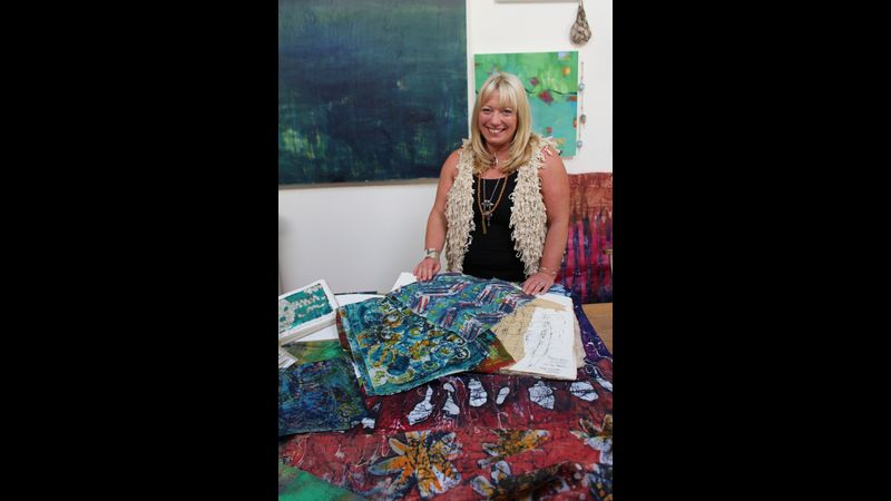 Me in my studio space with examples of my work