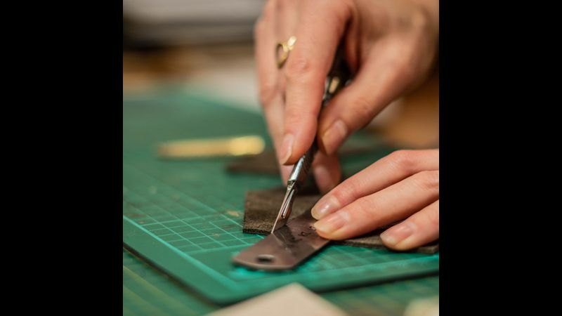 Cutting leather using a ruler and scalpel