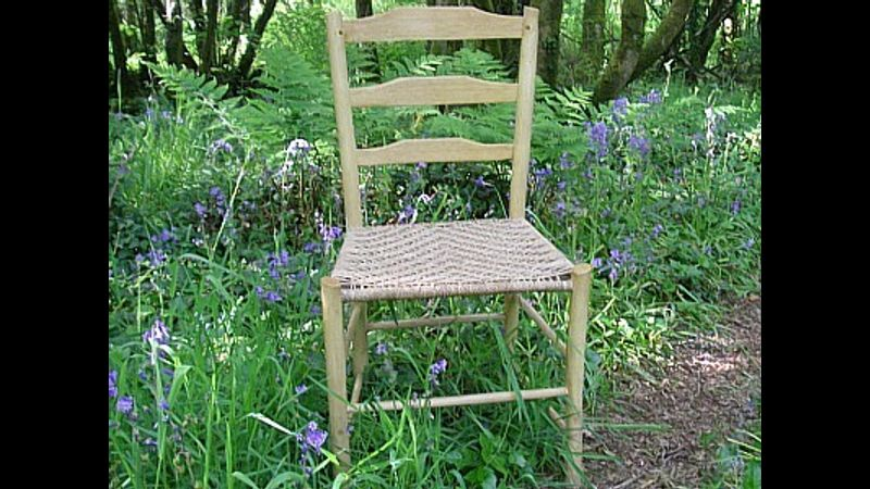 A finished ladder-back chair with Sea-grass seat