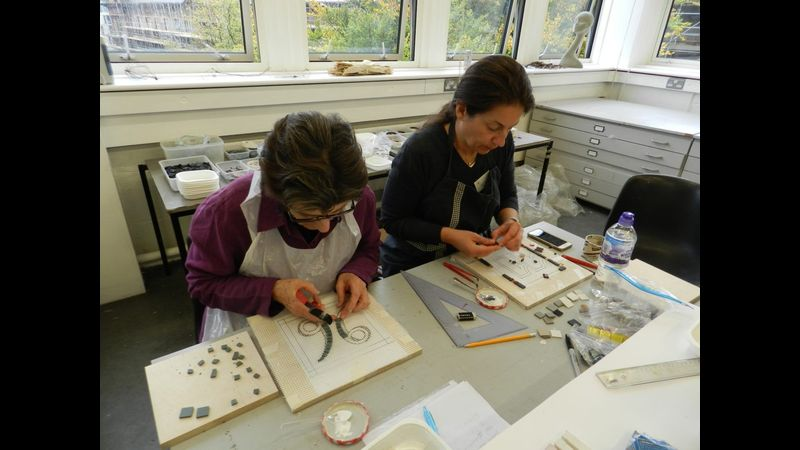 Students making mosaic house numbers on mesh