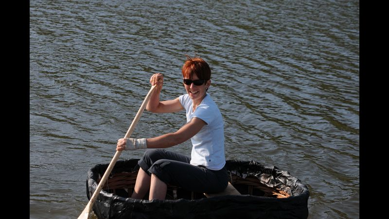 Jane paddling one of her coracles