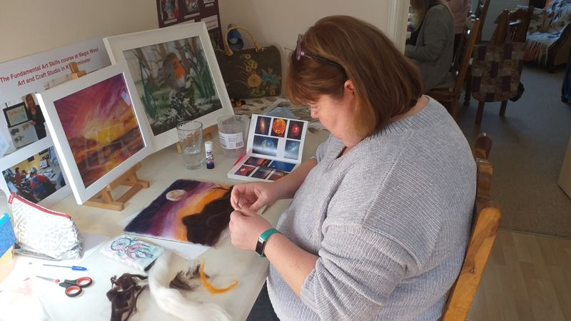 Creating a wool fibre painting during online course