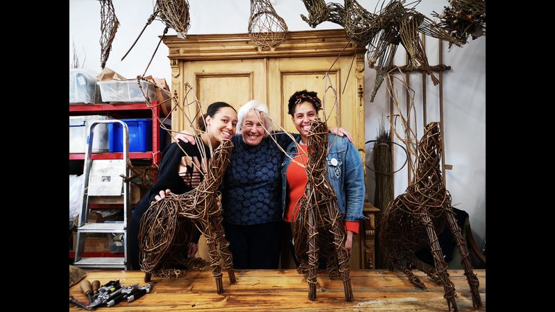 proud students and willow hare sculptures