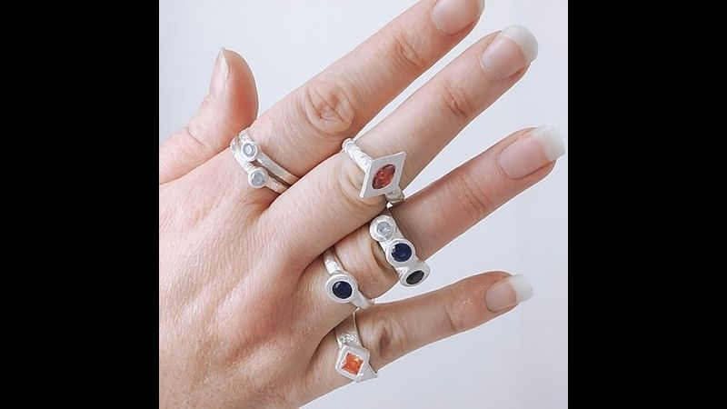 Handful of rings created on The Arienas Collective silver clay ring making workshop