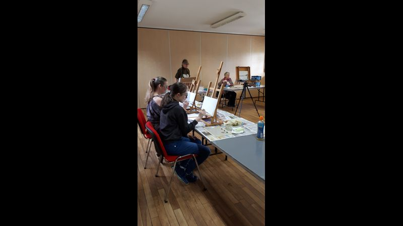Students painting in a relaxed atmosphere
